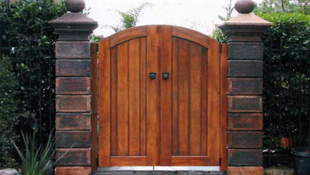 wire panel pinned to the center like the rest of the hog wire fence wooden gates are purely functional and are made to blend as opposed to entry gates
