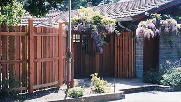04_ Curved Fence and Gate in Gorgeous Larkspur Home.jpg