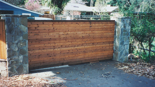 76_Sleepy Hollow Steel Framed Driveway Entry Gate Between River Rock .jpg
