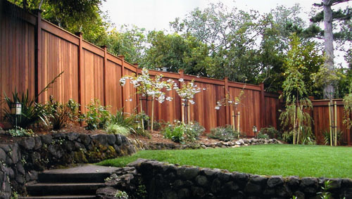 03_clear redwood fence and stone wall.jpg