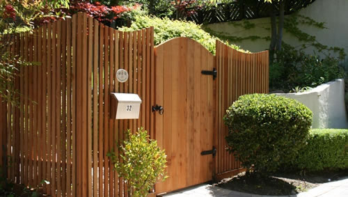 27_san anselmo scalloped front picket fence with arched gate.jpg