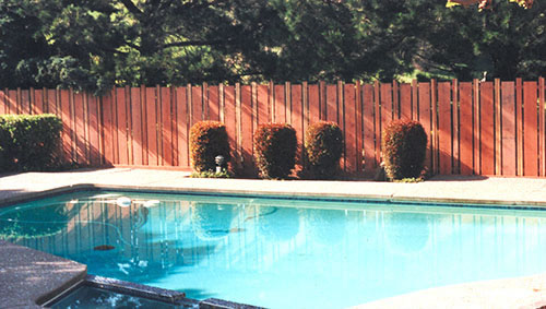37_marinwood pool area fence with alternating width fence boards .jpg