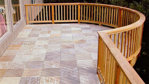 24_larkspur stone deck with round railing.jpg