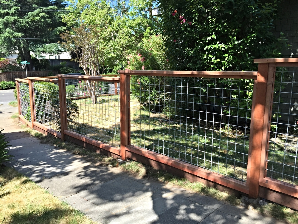 """Beautiful, simple, FSC Redwood with Hog Panel """"stepping down"""" to frame the yard San Anselmo"""