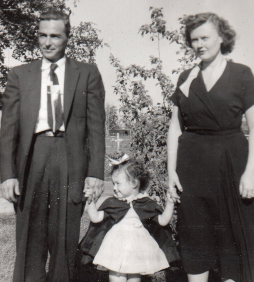 The author's grandfather and grandmother with his mother.