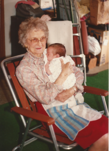 Vesta and great-grandson (and apron), 1991