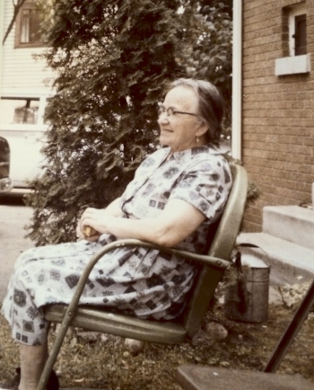 the author's grandmother sitting in her yard