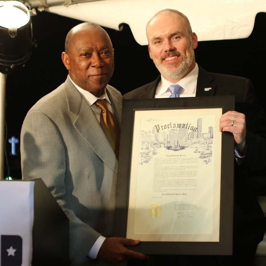 Mayor Turner presenting the proclamation of Combined Arms Day to Executive Director Kelly Land (USN). Photo credit: Andrew Wolf