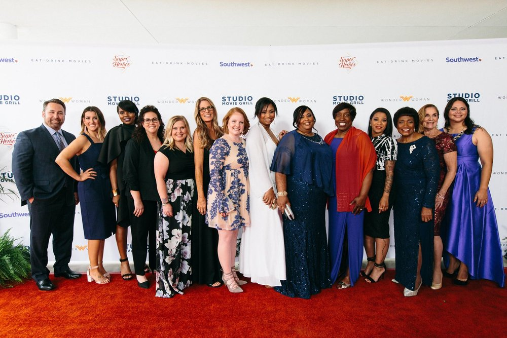 Monique Rodriguez (R) with 14 woman from across the United States that were honored with the Wonder Woman Award.
