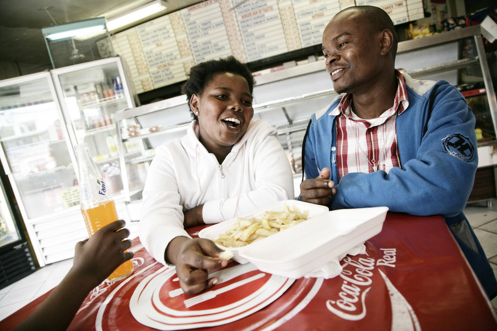 Zukile Ngamlana and his sister Phindiswa at the fish-and-chips, Khayamandi, Stellenbosch.