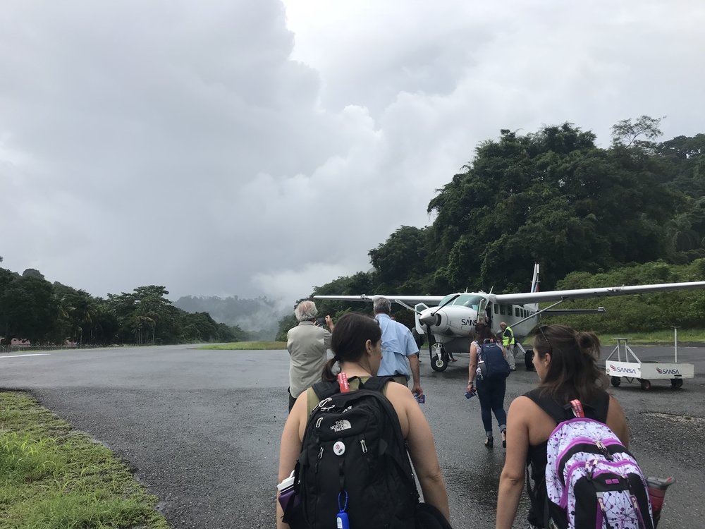 this is the 'airport' in golfito: the landing strip you see, and about 10 yards away, a little tin roof covered, open air terminal with 4 benches.