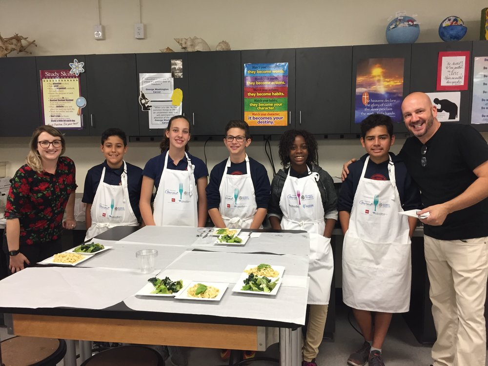 The winning 8th grade team with Chef Instructors Kevin Fonzo and Allyson Schurig
