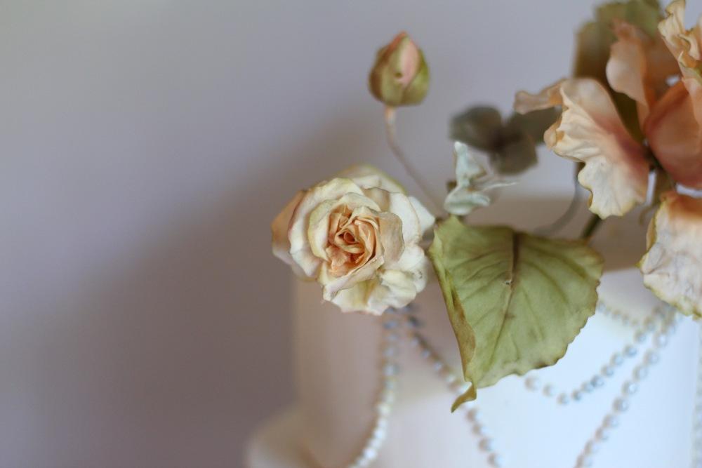 ivory sugar rose by jaime gerard cake