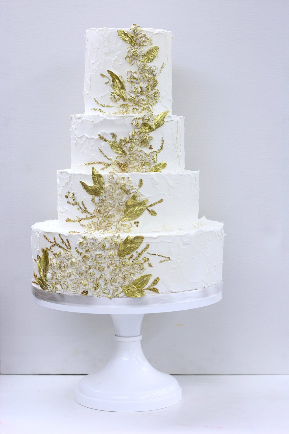 white textured cake with gold bas-relief by Jaime Gerard Cake 2017wm.jpg