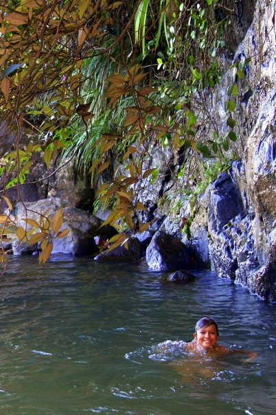 Refreshing natural swimming hole above a waterfall - deep in the jungle and private.