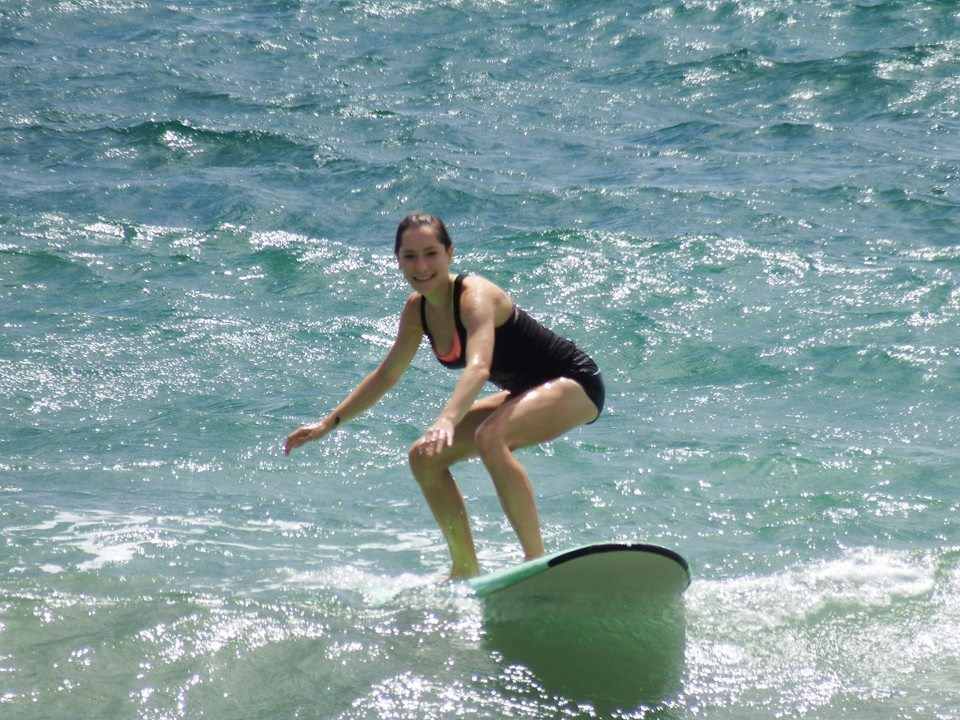 "Melina Devoney riding her first wave to ""La Pared"" in Luquillo Beach"