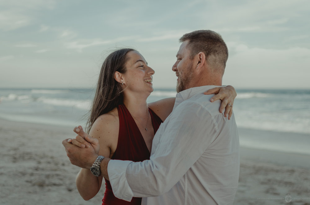intimate engagement session dancing on beach wrightsville beach, nc