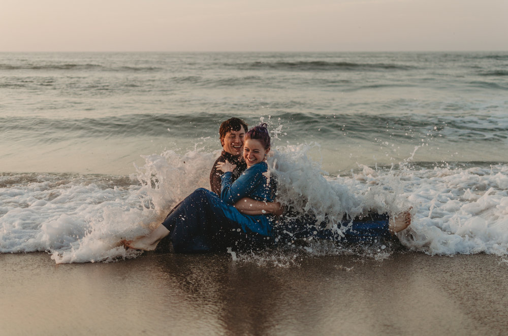 intimate couples photography beach session at wrightsville beach nc near wilmington nc wearing blue bohemian laced back maxi dress and purple hair