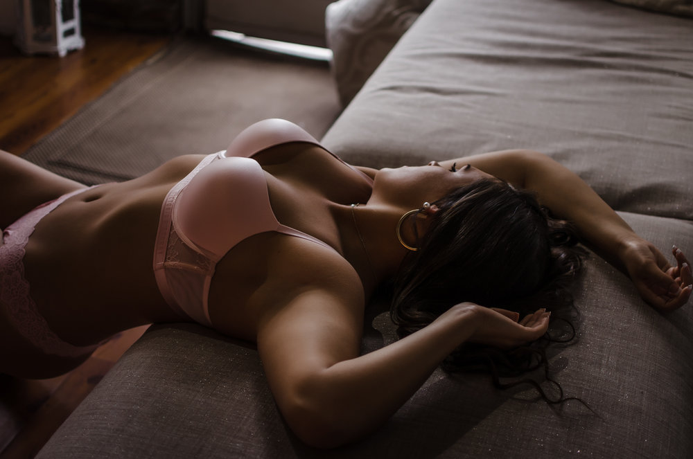 NC boudoir photography experience in belle vue wilmington venue with pink bra and pink lace panties by Victoria Secret by Amandamarie Gillen Photography Wilmington NC photographer laying arched back with shadows and body light trails
