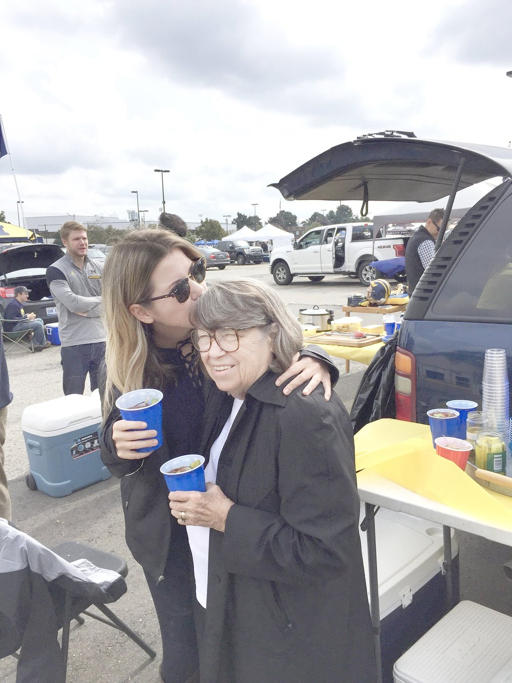 Moom and me enjoying bloodies at a tailgate