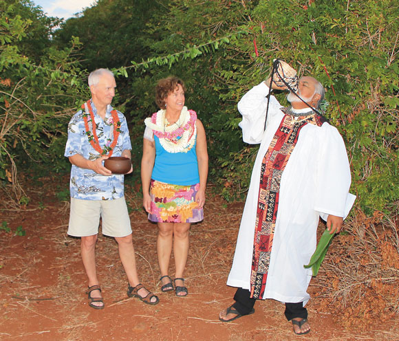 """We feel it's important to respect the land and cultural   traditions,"" said Kathy, who was trained as an anthropologist while attending law school. Chris and Kathy are pictured with Rev. Pomaikai Kaahumanu during the blessing of their Ka`anapali Coffee Farms lot."