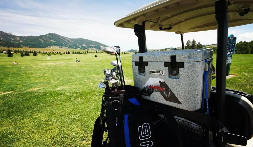 Alpha Pro Series 22 Quart Cooler on the back of a golf cart