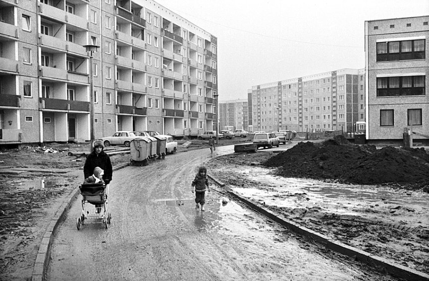 Leipzig Grünau (up to 45'000 population), I lived here with my parents from 1983 to 1985. The mud in the streets was a constant challenge. You could see scores of people with a pair of shoes entering the trams and trains to switch with their rubber boots.