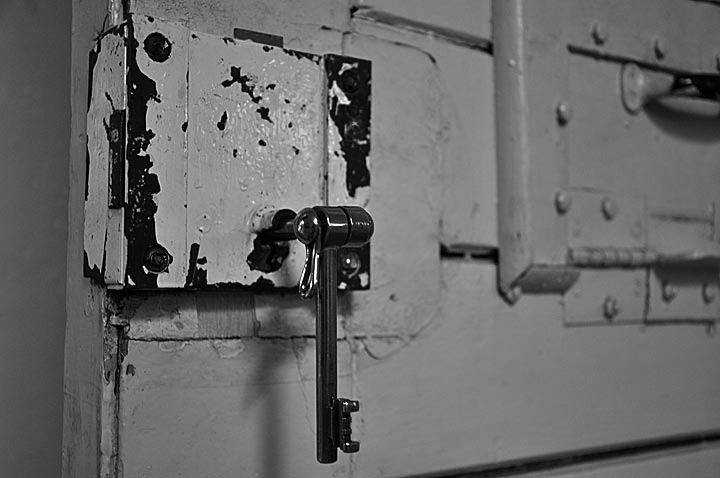 Stasi pre-trial prison door with metal key. It seemed that the guards purposely used speed and force to open the doors for some added shock value.