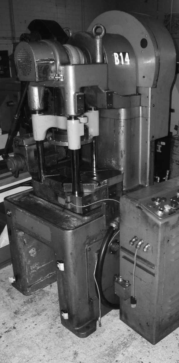 Punch press machine as used at MEWA by the political prisoners in Naumburg, GDR. IKEA used the parts for many years