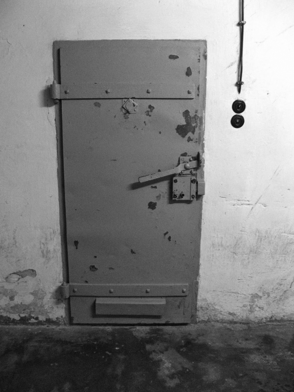 basement-prison-cell-door.jpg