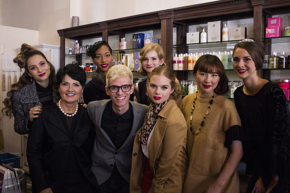 Cyndi Clark (1st row left) stands with Creative Director Aaron Pelo and the rest of the models for the 1940's-themed show.