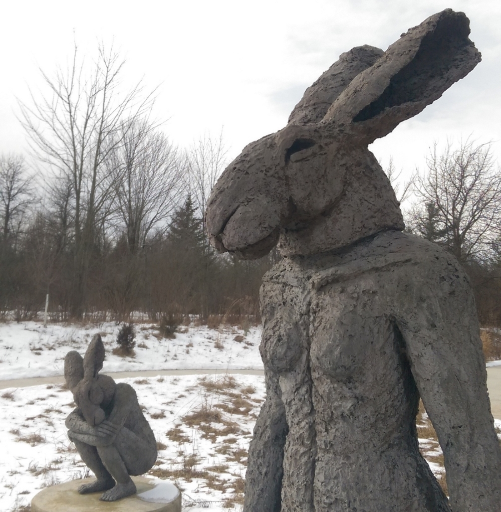 Rabbit-men in the Sculpture Park call to mind Lewis Carroll's fiction writing.