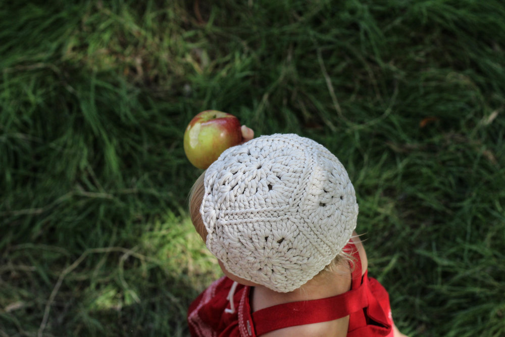 crochet baby bonnet and apple