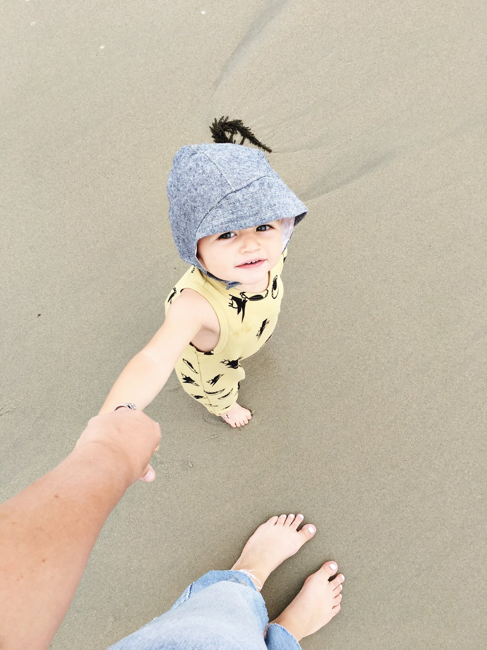 Baby boy sun bonnet for beach walks with mom, via Blue Corduroy on Etsy. Photo by Sarah Holstrom