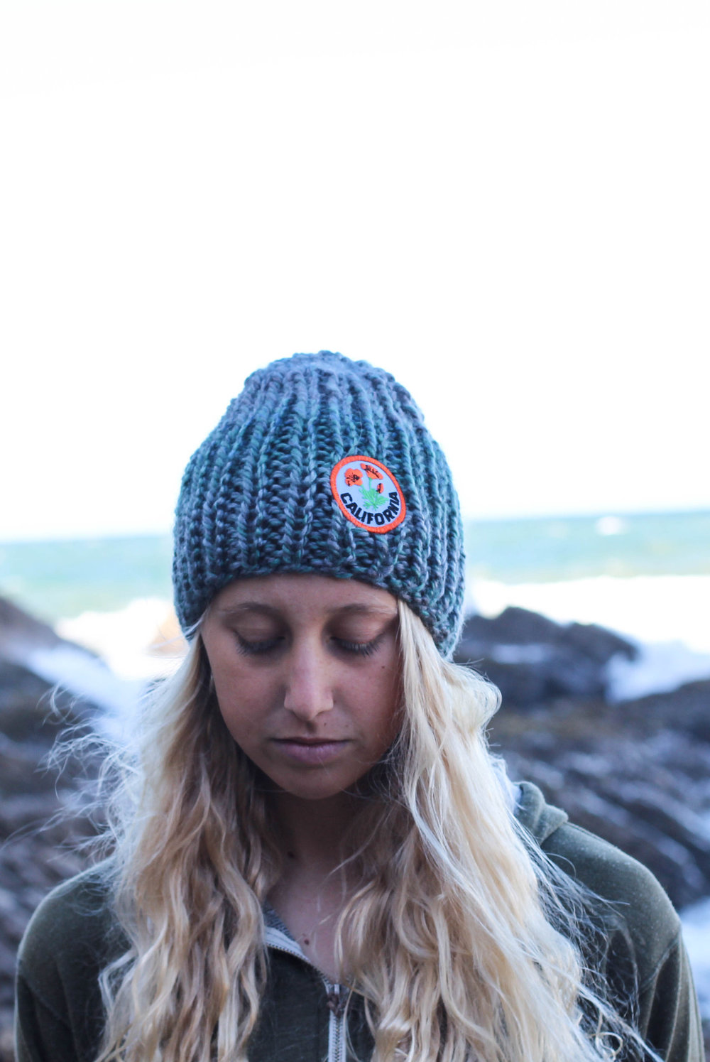 hand knit blue beanie with California Poppy patch by blue corduroy.etsy.com