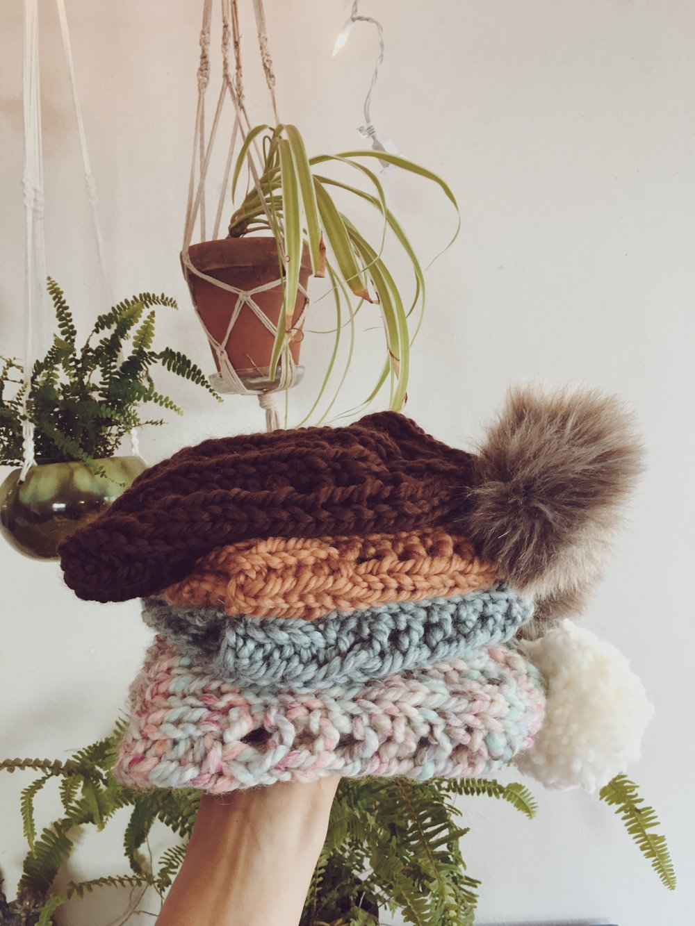 stack of knit beanies