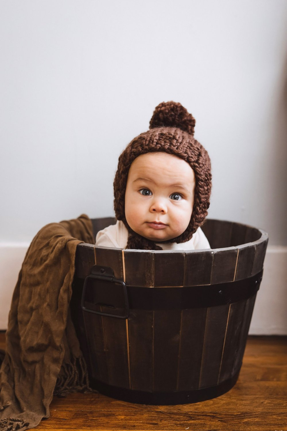 Is there anything cuter than a baby in a bonnet in a barrel? Photo credits  @kindred_indigo