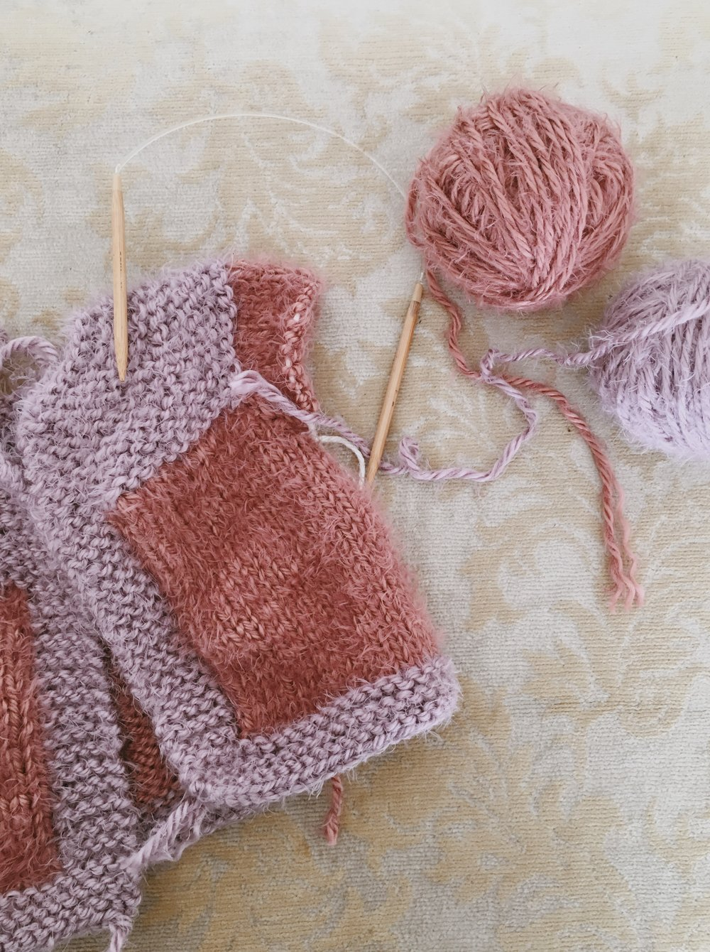 knitting sleeves with a circular needle on baby sweater