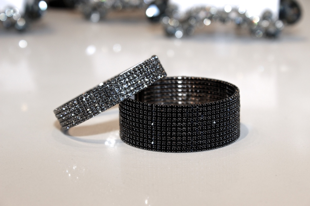 "These sparkly and fun gunmetal bracelets, we call ""Dark Beauty"".  Gunmetal jewelry is our go-to when accessorizing outfits with dark colors.  It solidifies the theme and compliments the mood!"