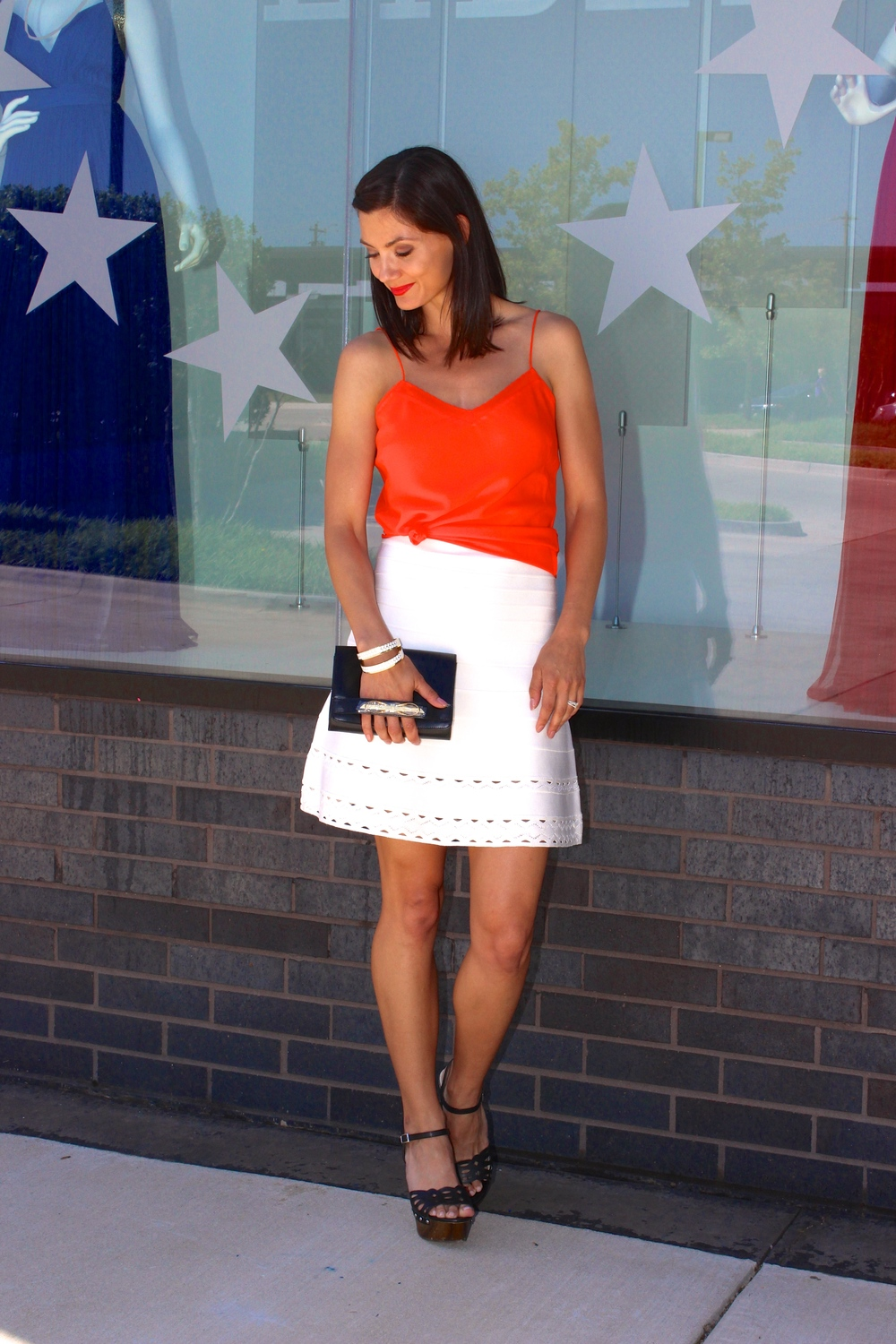 Ted Baker Scallop Edge Cami in Dark Orange  Hervé Leger Flare Skirt in Alabaster  Ted Baker Enamel Bangles in White & Gold Ted Baker Torrey Metal Slim Bow Leather Crossbody in Black ALL AVAILABLE IN STORE ONLY - INFO@GIVEMELIBERTE.COM