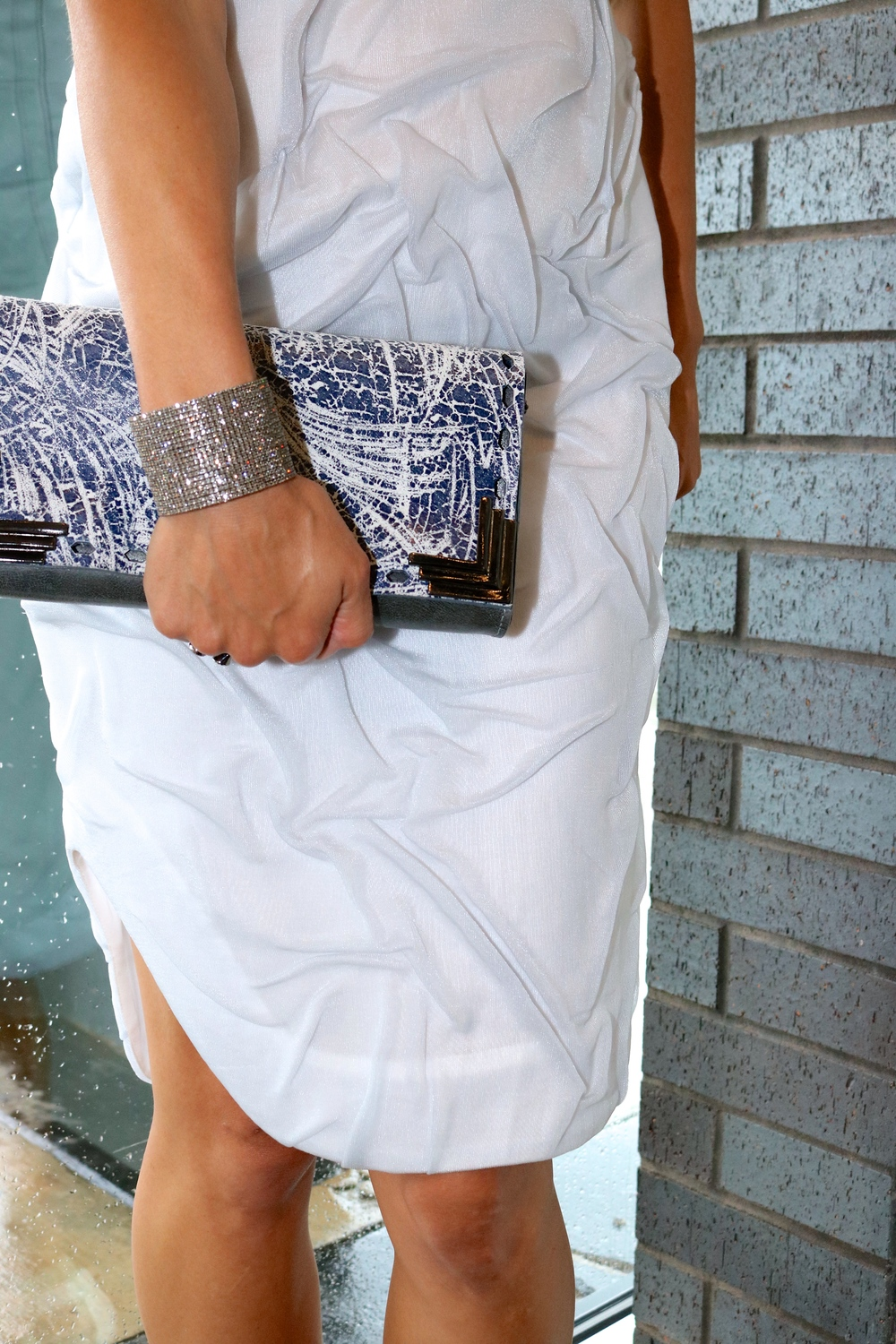 Leather clutch and Soft Crystal bracelet are only available in-store.