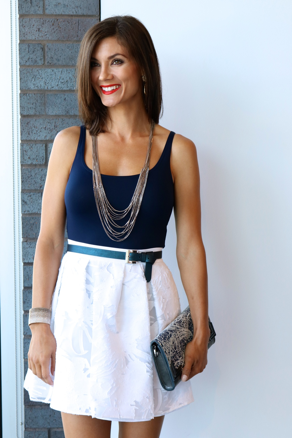 Only Hearts tank in navy, Waldrip NYC skirt, and accessories are all available in-store.