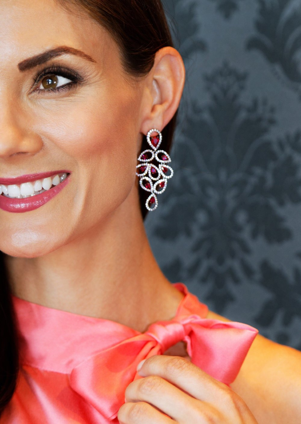 Majestic Silk Front Tie Neck Top, Sorbet. Gaia Chandelier Earrings, Ruby/Gnmtl. Available in store.
