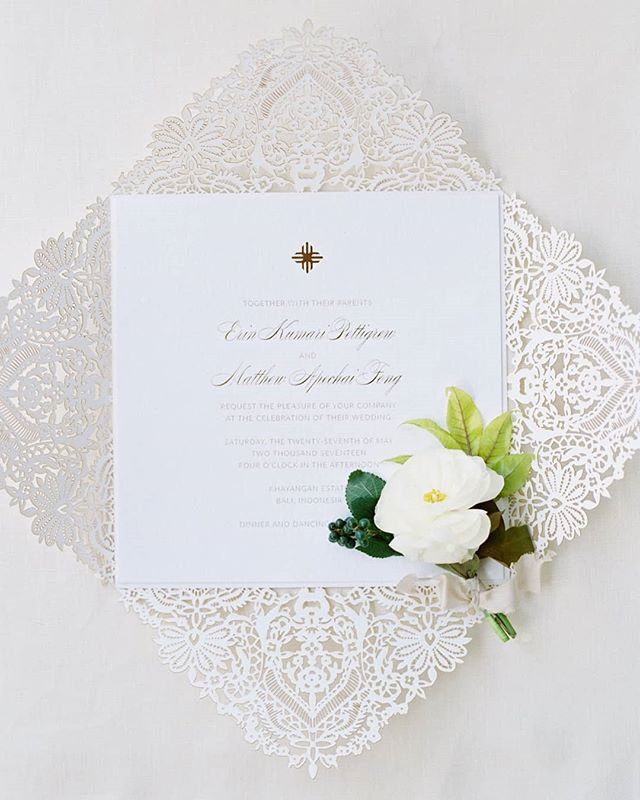 FEATURE // Visit @stylemepretty to see today's feature of this beautiful Bali wedding designed by @joyproctor along with @bowsandarrowsflowers and @erichmcvey. This custom laser cut invitation was inspired by the embroidery on the brides dress by @naeemkhanbride and paired with a modern gold EM monogram.  CREATIVE TEAM // @yonderdesign @joyproctor @erichmcvey @theweddingatelier.co @bowsandarrowsflowers @naeemkhanbride @naeemkhannyc @balieventhire @khayanganestates @thehosttable @hillmas_pro @balicateringcompany @yeann_makeupart @paper_diamonds  TAGS // #destinationwedding #joyproctor  #yonderdesign #yonder #yonderevents #bali #baliwedding #wedding #invitations #goldfoil #lasercut #invites #lace #weddinglace #embroidery #petalfold #foldedinvitation #joyproctordesign #bowsandarrowsflowers #stylemepretty #stylemeprettyweddings #custominvitations #uniqueinvitation #whiteinverson #whitewedding #beachwedding