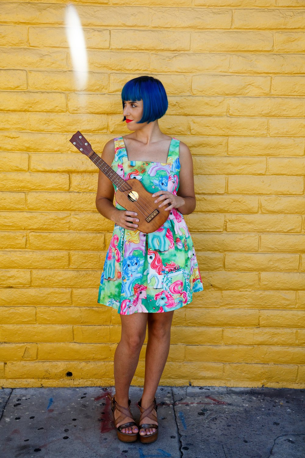 Peanut uke pony dress yellow brick wall.jpg