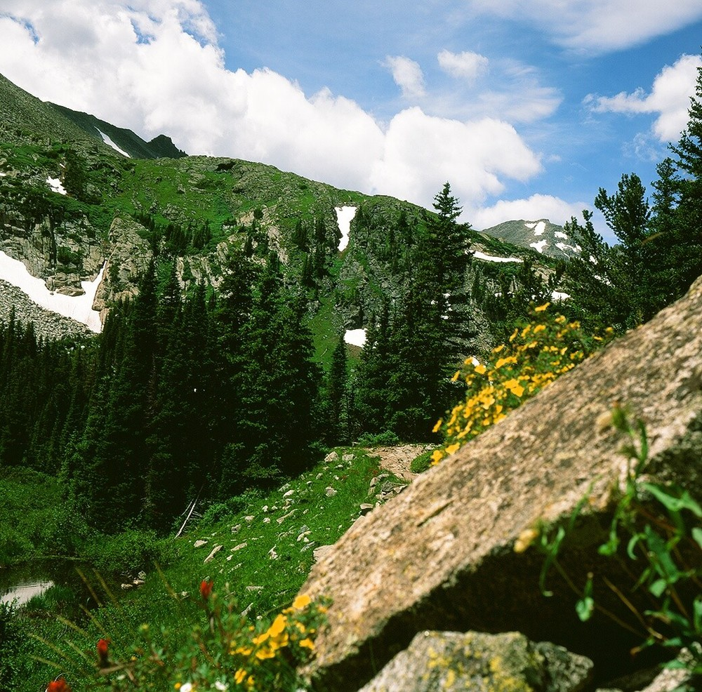 A photograph taken in the Indian Peaks region of the Rocky Mountains using a Graflex 22 Model 200, and using Fuji Velvia slide film.