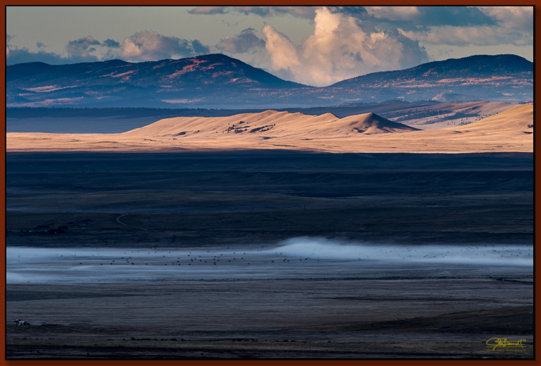 """""""South Park Expanse"""" ©2016 Jon S. Berndt   The view of South Park, south from Kenosha Pass. From fog to sunlight to distant mountain range, I enjoyed this view for it's massive depth."""