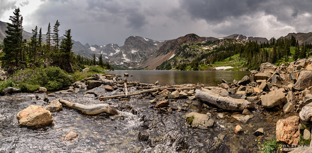Lake Isabelle on a day when the weather couldn't decide (at this moment) whether it was going to unleash thunderbolts and torrential rain, or whether the Sun would shine. Later, the thunderbolts and lightning came, and the Sun soon followed.(C) 2017 Jon Berndt Photography
