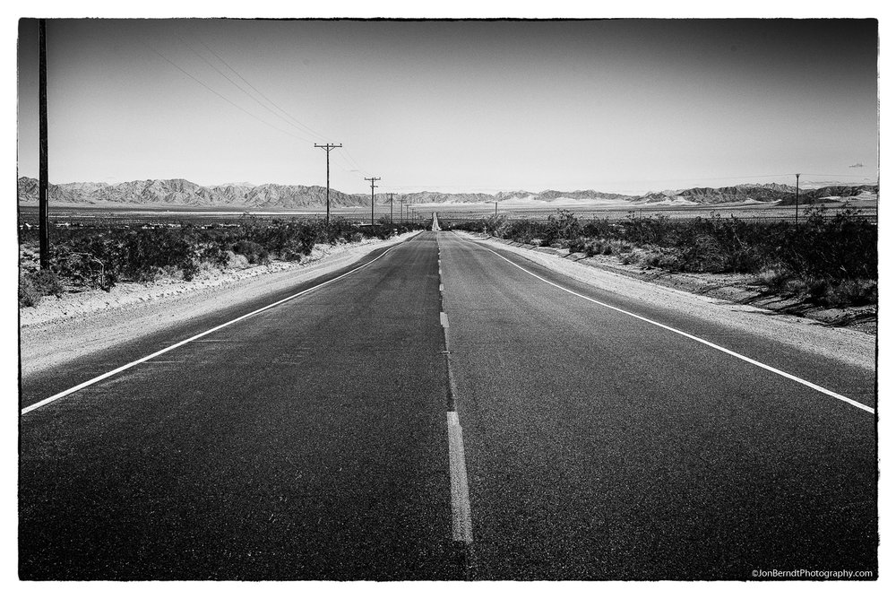 """Twentynine Palms Highway - also known as Route 62. Looking east here. There's a good essay in the New York Times about this area.   In the California Desert: Vast Darkness, Vibrant Music, an Oasis   """"In Wonder Valley, the silence makes its own kind of noise. And Twentynine Palms makes its own kind of music."""""""