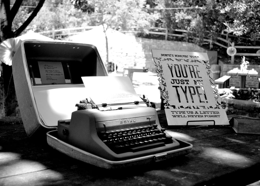 Typewriter guestbook with laser cut sign